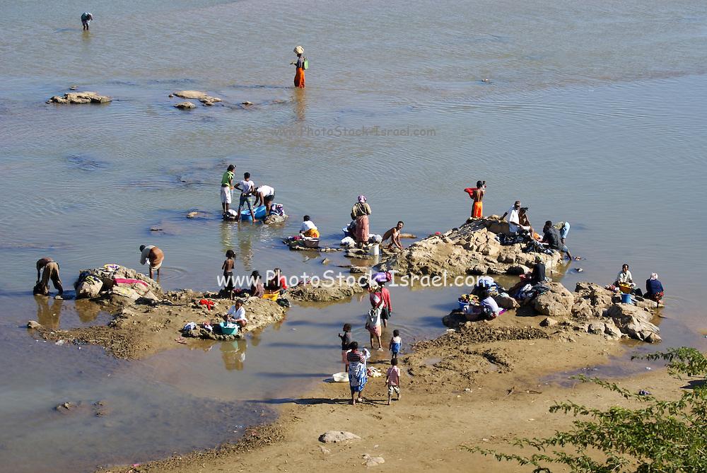 Madagascar, Anosy region, River landscape near Antananarivo, Women washing clothes in the river