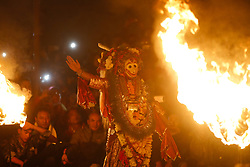 November 22, 2018 - Lalitpur, Nepal - A Nepalese artist dressed as Lord Narsimha performs during Kartik Nach festival at midnight in Lalitpur, Nepal. The religious dance is performed over ten days in the Nepalese calendar known as Kartik to thank Lord Kumara for his protection. The devout King Siddhi Narsingh Malla first established the Kartik Nach in the 17th century. (Credit Image: © Skanda Gautam/ZUMA Wire)
