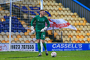 Aidan Stone of Mansfield Town (31) kicks the ball clear during the The FA Cup match between Mansfield Town and Dagenham and Redbridge at the One Call Stadium, Mansfield, England on 29 November 2020.