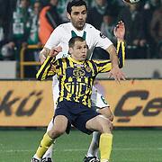 Bursaspor's Bekir Ozan HAS (B) and Ankaragucu's Drago GABRIC (F) during their Turkish soccer super league match Bursaspor between Ankaragucu at Ataturk Stadium in Bursa Turkey on Monday, 21 March 2011. Photo by TURKPIX