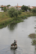 A fisherman in the Almonda river near Jose Saramago's birth place Aldeia da Azinhaga, central Portugal . Portuguese Nobel Prize of Literature, Jose Saramago, died at his house in Lanzarote on June 18. PAULO CUNHA/4SEEPHOTO