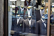 classic male and female business suits window display in Japan
