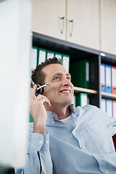 Young man sitting office headset computer