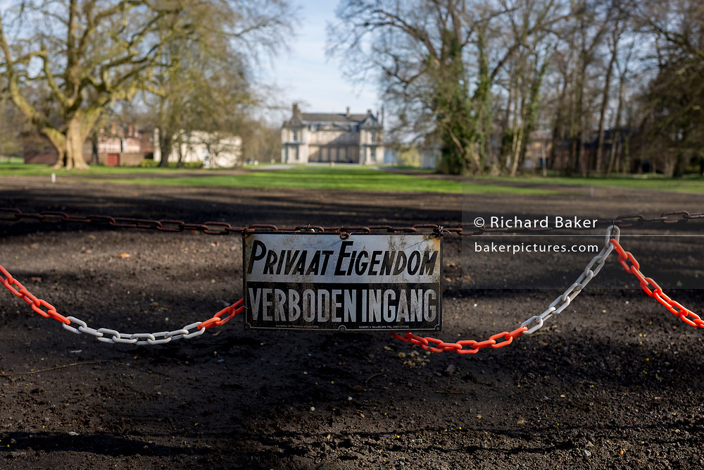 No entry sign at the entrance of the privately-owned de Merode Castle, out of bounds for locals, on 25th March, in Everberg, Brabant, Belgium. de Merode castle was built in the 16th century and contains three separate buildings: the residence, a building for the animals, a building for employees and the stabling of carriages. Everberg is a town in the Belgian province Flemish-Brabant and is part of the municipality of Kortenberg.