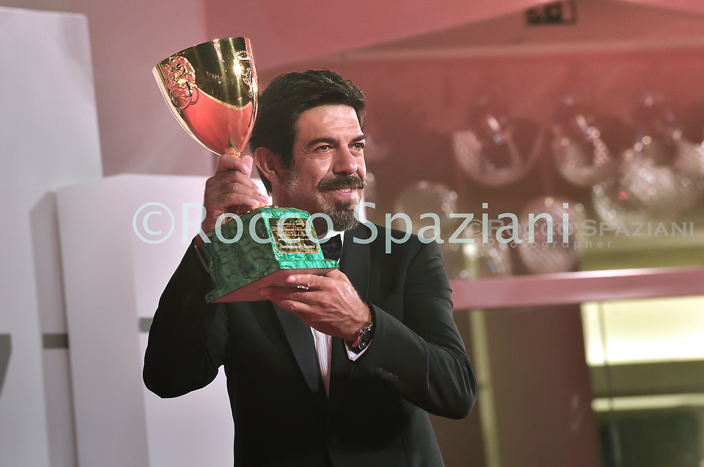 VENICE, ITALY - SEPTEMBER 12: Pierfrancesco Favino poses with the Coppa Volpi for Best Actor during the winners photocall at the 77th Venice Film Festival on September 12, 2020 in Venice, Italy. .<br /> (Photo by Rocco Spaziani)