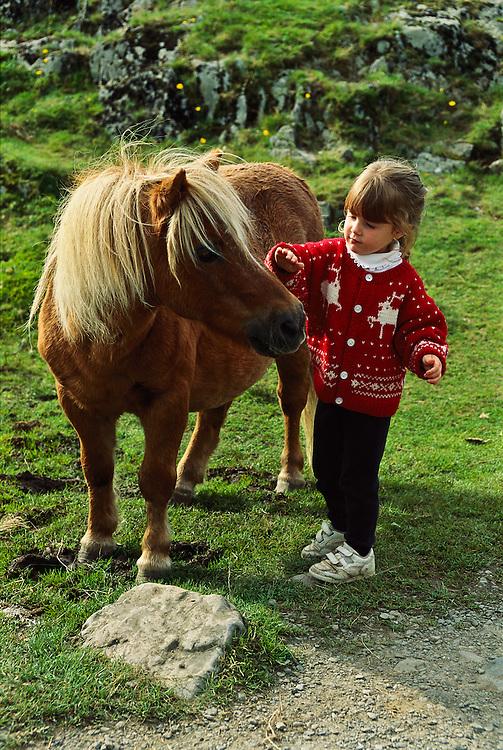 A girl and a Shetland Pony.