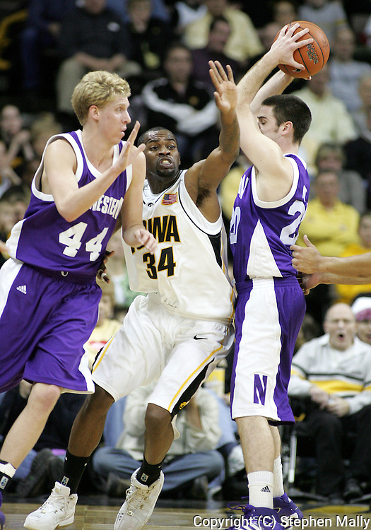 15 FEBRUARY 2007: Iowa forward Tyler Smith (34) gets caught in between Northwestern forward Kevin Coble (44) and guard Craig Moore (20) in Iowa's 66-58 win over Northwestern at Carver-Hawkeye Arena in Iowa City, Iowa on February 15, 2007.