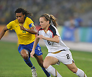Beijing, CHINA.   Olympic Football, Women's Gold  Medal Game, USA vs BRA., Brazil's TANIA, and USA Amy RODRIGUEZ, at the Beijing Workers Stadium. Thursday,  21.08.2008 [Mandatory Credit: Peter SPURRIER, Intersport Images]