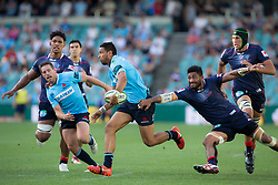 March 17, 2018 - Sydney, NSW, U.S. - SYDNEY, NSW - MARCH 18:  Rebels player Reece Hodge (12) breaks a tackle at round 5 of the Super Rugby between Waratahs and Rebels at Allianz Stadium in Sydney on March 18, 2018. (Photo by Speed Media/Icon Sportswire) (Credit Image: © Speed Media/Icon SMI via ZUMA Press)