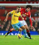 James McArthur of Crystal Palace and Marouane Fellaini of Manchester United - Manchester United vs. Crystal Palace - Barclay's Premier League - Old Trafford - Manchester - 08/11/2014 Pic Philip Oldham/Sportimage