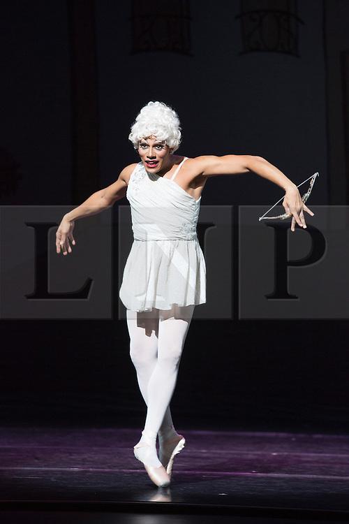 © Licensed to London News Pictures. 18/09/2015. London, UK. Olga Supphozova (Robert Carter) as Amour. Les Ballets Trockadero de Monte Carlo (The Trocks) perform the UK premiere of Don Quixote during a photocall at the Peacock Theatre. With Yakaterian Verbosovich (Chase Johnsey) as Kitri, Vyacheslav Legupski (Paolo Cervellera) as Basil, Olga Supphozova (Robert Carter) as Amour, Lariska Dumbcheno (Raffaele Morra) as Mother, Boris Nowitsky (Carlos Renedo) as Count and Varvara Bractchikova (Giovanni Goffredo) and Eugenia Repelskii (Joshua Thake) as Gypsies. Photo credit: Bettina Strenske/LNP