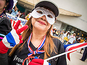 """14 JULY 2013 - BANGKOK, THAILAND:  An anti-government protester in Bangkok Sunday. About 150 members of the so called """"White Mask"""" movement marched through the central shopping district of Bangkok Sunday to call for the resignation of Yingluck Shinawatra, the Prime Minister of Thailand. The White Mask protesters are strong supporters of the Thai monarchy. They claim that Yingluck is acting as a puppet for her brother, former Prime Minister Thaksin Shinawatra, who was deposed by a military coup in 2006 and now lives in exile in Dubai.       PHOTO BY JACK KURTZ"""