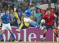 Italy v Sweden - Estadio Dragao, Porto - 18th June 2004<br />Italy's Gianluca Zambrotta tries to clear the bouncing ball as Sweden's Freddie Ljungberg attempts the overhead kick<br />Photo: Jed Leicester/Sporting Pictures<br />© Sporting Pictures (UK) Ltd<br />www.sportingpictures.com<br />Tel: +44 (0)20 7405 4500<br />Fax: +44 (0)20 7831 7991