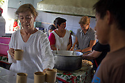 """Volunteers of migrants shelter in Tenosique """"La 72"""", bring food and water to central american migrants on October 14th, 2012. Mothers of central american migrants from Honduras, El Salvador, Guatemala and Nicaragua (claimed as disappeared in Mexico) will travel on a caravan from October 15t through 23 locations in 14 mexican states during 20 days. (Photo: Prometeo Lucero)"""