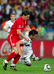 Gareth Barry of England vs Zlatan Ljubijankic of Slovenia during the 2010 FIFA World Cup South Africa Group C Third Round match between Slovenia and England on June 23, 2010 at Nelson Mandela Bay Stadium, Port Elizabeth, South Africa. England defeated Slovenia 1-0 and qualified for the next round, Slovenia not. (Photo by Vid Ponikvar / Sportida)
