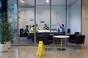 An employee raises his hand during airport operator BAA's company meeting at Heathrow's Terminal 5.