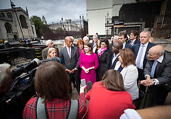 © Licensed to London News Pictures. 30/09/2019. London, UK. Liberal Democrat Leader Jo Swinson stands with fellow MPs Chuka Umunna,  Layla Moran, Sam Gyimah and others as she makes a statement outside Parliament. Earlier a meeting of opposition leaders was held to discuss a plan to force the Prime Minister to go to Brussels to seek another Brexit delay as early as this weekend. Photo credit: Peter Macdiarmid/LNP
