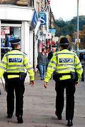 Policeman & Community Support Officer patrol Skipton High Street; Yorkshire UK