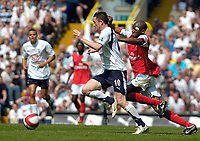 Photo: Ed Godden/Sportsbeat Images.<br /> Tottenham Hotspur v Arsenal. The Barclays Premiership. 21/04/2007. Spurs' Robbie Keane (L), gets away from Abou Diaby.