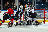 KELOWNA, BC - DECEMBER 18:  Referee Matt Hicketts jumps onto the net for a birds eye view of the puck as David Tendeck #30 of the Vancouver Giants defends the net against the Kelowna Rockets at Prospera Place on December 18, 2019 in Kelowna, Canada. (Photo by Marissa Baecker/Shoot the Breeze)