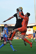 Luke Daniels of Scunthorpe United takes the ball safe against Michael Smith of Barnsley FCduring the Sky Bet League 1 match between Scunthorpe United and Barnsley at Glanford Park, Scunthorpe, England on 31 October 2015. Photo by Ian Lyall.