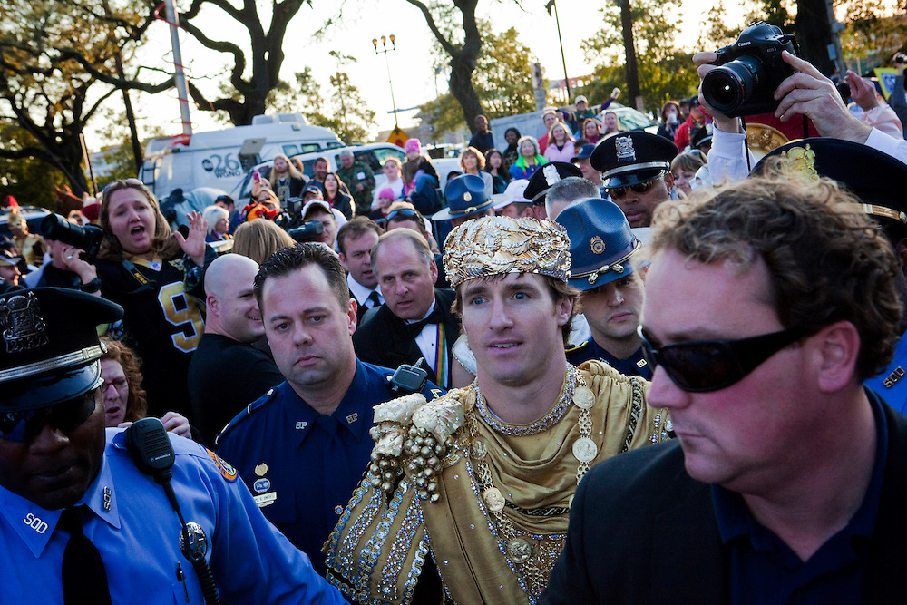 Super Bowl MVP and New Orleans Saints Quarterback Drew Brees #9 as reigning King of Bacchus is escorted to the King's float in the Krewe of Bacchus parade as they get ready to roll at Tchoupitoulas Street and Napoleon Avenue in New Orleans, Louisiana. USA.