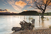 Ullswater in the Lake District close to sunset, following periods of heavy rain, resulting in the flooding of the foreshore.