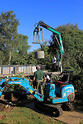 Delivery and installation of concrete ring for domestic septic tank system, Suffolk, England, UK