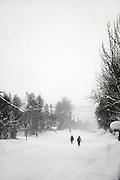 People walk through the snowy, frozen streets of Kirkeness in Finnmark region, northern Norway