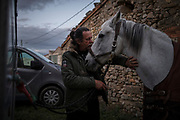 Swiss/Italian pilgrim Claudio Modola, pats his horse, Cortez, as he prepares for the day's ride on his 44 days' horseback journey from the Spain-France border across four different Spanish regions on a 870 Kilometres trek on the Way of St. James, or El Camino de Santiago, a network of ancient pilgrim routes stretching across Europe and converging at the tomb of St. James (Santiago in Spanish) in Santiago de Campostela in northwest Spain, on October 23, 2020 in Grañón, a village in the province of La Rioja, Spain. The Camino de Santiago is being affected by Covid-19 with strict restrictions regarding services and mobility along the routes. Starting October 30, 2020, Spanish authorities closed among others, the  perimeter of Santiago de Compostela. Only pilgrims that have been journeying before October 30 can stop at the cathedral of Santiago de Campostela, but they are not allowed to stay overnight and have to transit through.