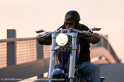 Arlen Ness riding his custom known as the Gibson Bike down the ramp from the 2nd story of the shop. Dublin, CA. 2004. Photograph ©2004 Michael Lichter