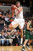 Nov. 12, 2010; Charlottesville, VA, USA;  Virginia Cavaliers guard Joe Harris (12) grabs a rebound during the game against William & Mary at the John Paul Jones Arena.  Mandatory Credit: Andrew Shurtleff