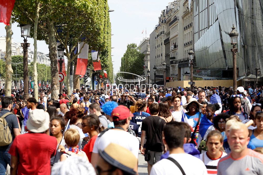 Crowd during the parade of the team France on Champ-Elysées after winning the 2018 FIFA World Cup Russia on July 16, 2018 in Paris, France - Photo Frederic Le Floc'h / ProSportsImages / DPPI
