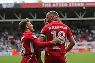 Bristol Aaron Wilbraham (18) celebrates his goal with his team mate. 1-1  during the EFL Sky Bet Championship match between Bristol City and Derby County at Ashton Gate, Bristol, England on 17 September 2016. Photo by Gary Learmonth.