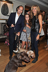 MR & MRS GEORGE GOULANDRIS, their daughter MARIETTA and their dog at the 10th anniversary of George in association with The Dog's Trust held at George, 87-88 Mount Street, Mayfair, London on 13th September 2011.