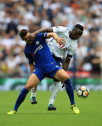 """Tottenham Hotspur's Victor Wanyama and Chelsea's Alvaro Morata battle for the ball during the Premier League match at Wembley Stadium, London. PRESS ASSOCIATION Photo. Picture date: Sunday August 20, 2017. See PA story SOCCER Tottenham. Photo credit should read: Mike Egerton/PA Wire. RESTRICTIONS: EDITORIAL USE ONLY No use with unauthorised audio, video, data, fixture lists, club/league logos or """"live"""" services. Online in-match use limited to 75 images, no video emulation. No use in betting, games or single club/league/player publications."""