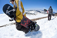Snowboarders hiking at Kirkwood resort near Lake Tahoe, CA.