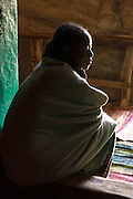 Young Woman at the inner entrance to Medhane Alem Adi Kesho Church, Adi Kesho, Tigray region. Ethiopia, Horn of Africa