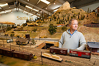 O Scale Trainmaster Jeff Rowe inside one of the layouts at the Golden State Model Railroad Museum in Point Richmond.