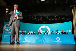 © Licensed to London News Pictures. 19/05/2019. Frimley, UK. Leader of The Brexit Party Nigel Farage stands in front of a bench of MEP candidates as he addresses supporters at a party rally in Frimley, Surrey, ahead of the European Elections. Photo credit: Rob Pinney/LNP
