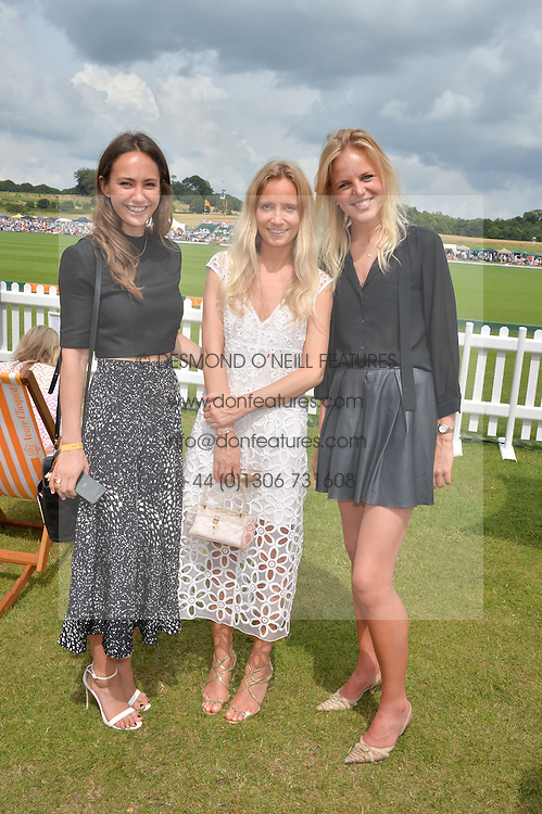 Left to right, LAVINIA BRENNAN, MARTHA WARD and JENNY DAWSON at the Veuve Clicquot Gold Cup Final at Cowdray Park Polo Club, Midhurst, West Sussex on 20th July 2014.