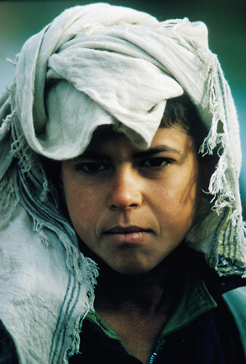 portrait of Marsh Arab boy in traditional headdress in the Marshes of Southern Iraq