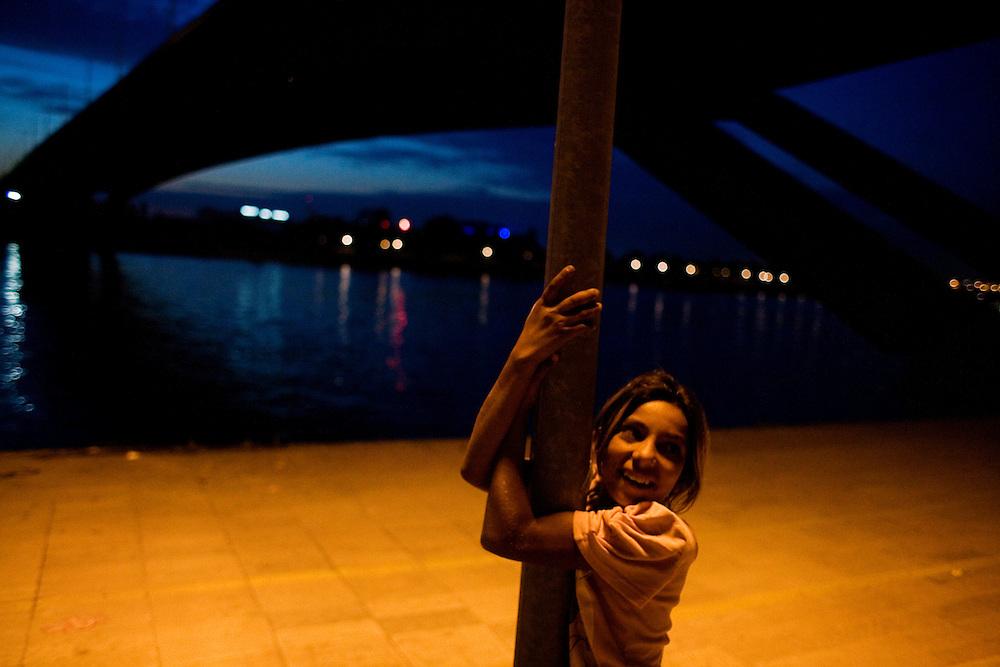 A girl playing underneath the Gazela bridge on the Sava river. Stara Gazela.