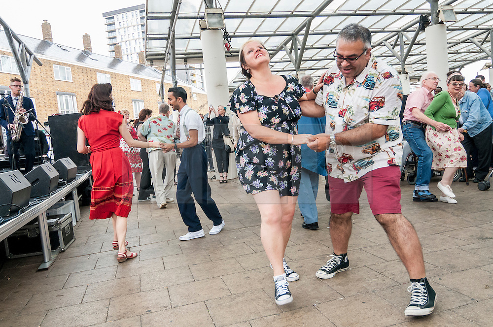 © Licensed to London News Pictures. 28/06/2015. London, UK. Members of the public dancing at the Swing East jump 'n' jive jamboree in Chrisp Street Market in London's East End.  Revellers gathered together in vintage clothing to celebrate fifties music and dance, lots and lots of dance. Photo credit : Stephen Chung/LNP