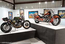 Steve Carpy Carpenter's Greenday Special Honda CB750K cafe racer (L) beside Kiwi Mike Tomas' first replica Indian in the Heavy Mettle - Motorcycles and Art with Moxie exhibition at the Sturgis Buffalo Chip. This is the 2020 iteration of the annual Motorcycles as Art series curated and produced by Michael Lichter. Sturgis, SD, USA. Friday, August 7, 2020. Photography ©2020 Michael Lichter.