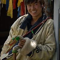 A Buddhist Tsam dancer waits to perform at the national naadam festival in Ulaanbaatar, Mongolia.
