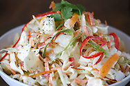 A bowl of cilantro , lime cole slaw.