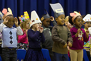 """Middletown, New York - Preschool and pre-K students sing a song during the """"YMCA Thanksgiving Day Spectacular"""" on the stage at the Center for Youth Programs on Nov. 27, 2013."""