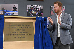 The Duke of Sussex unveils a plaque commemorating his visit to the OXSRAD Disability Sports and Leisure Centre, in Oxford.