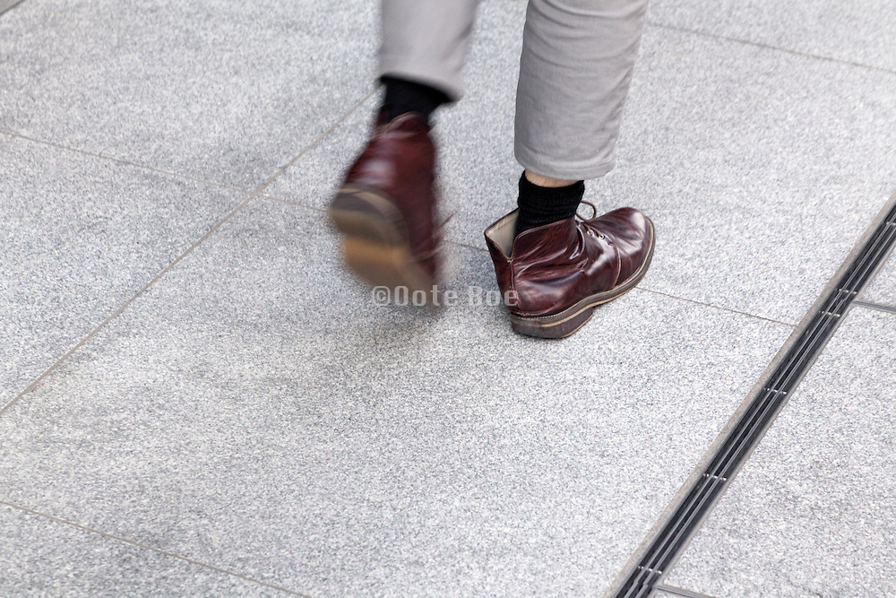 male person rushing forward with shoes loose on his feet